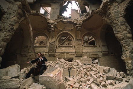Vedran Smailović plays his cello in the destroyed National Library, Sarajevo
