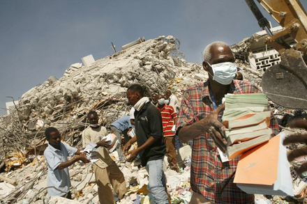 Workers painstakingly retrieve records from the ruins of the tax office; image courtesy of ICBS