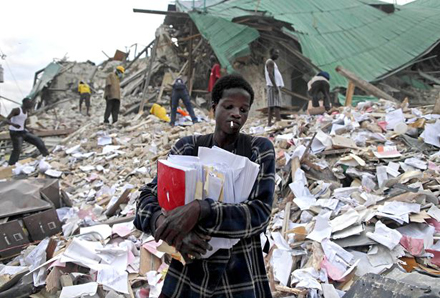 A man leaves after retrieving some documents from the rubble of a collapsed building in the aftermath of the 2010 in Port-au-Prince, Haiti. Photo: AP
