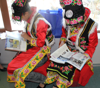 Two Qiang Girls Reading in the Library; Qiang Autonomous Prefecture of Beichuan County Library