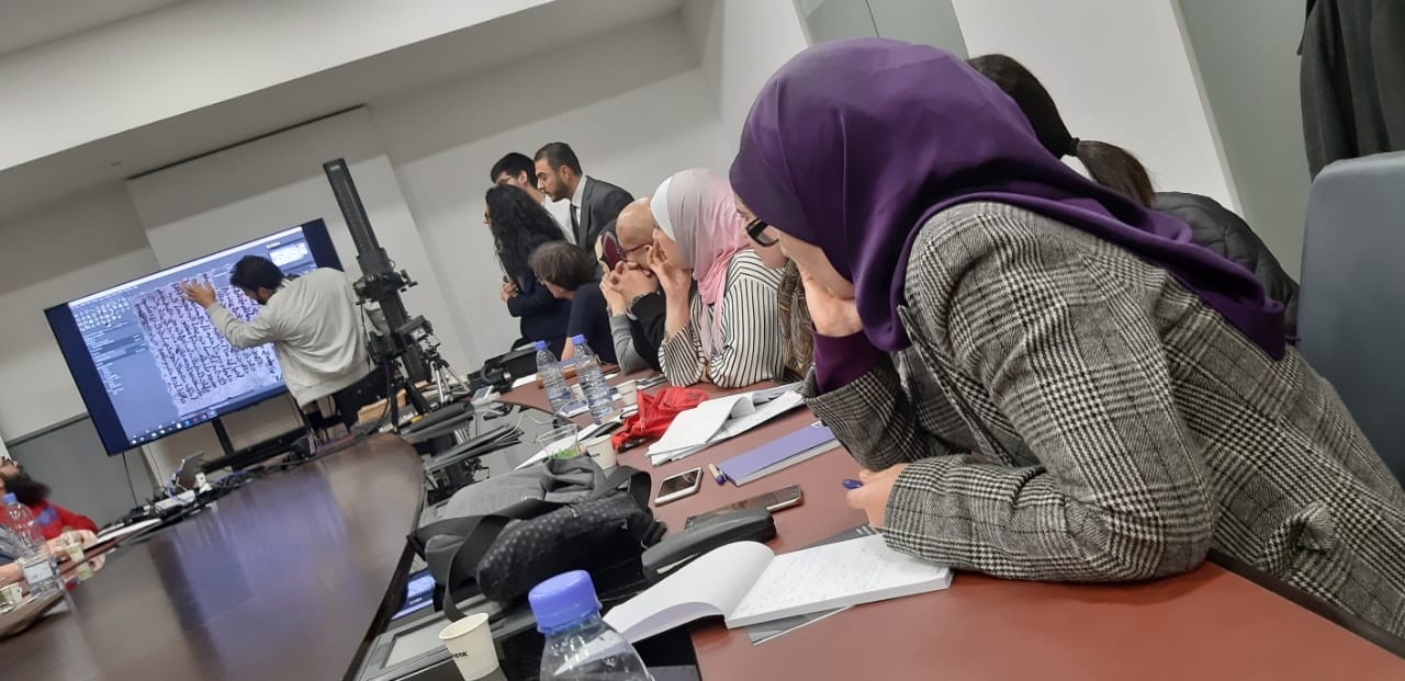 Attendees watch a demonstration during the workshop on methods for scientific examination of library objects.