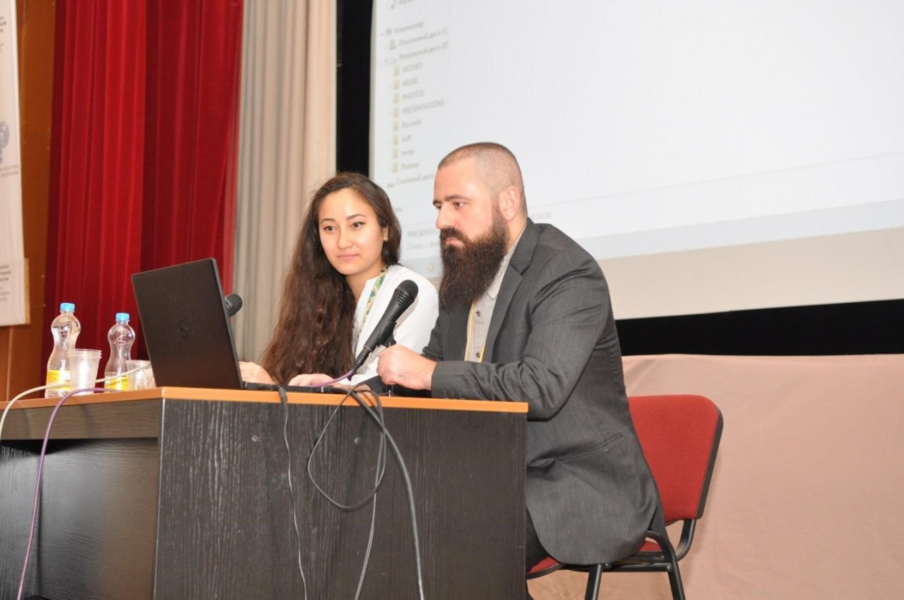 "Conservation specialists Mariia Kolpakova (L) and Fareed AlShishani (R) participate at the Interdisciplinary Scientific and Practical Conference ""Rare Books in the Context of Preservation""  in Moscow."